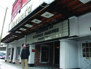 """A SECOND CHANCE: Oneonta Theatre owner, Tom Cormier, stands in front of the venue's marquee, announcing its first concert booked in partnership with """"Friends of the Oneonta Theatre."""""""