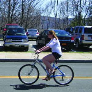 Sophomore Meghan Wilcox riding her bike instead of driving a vehicle